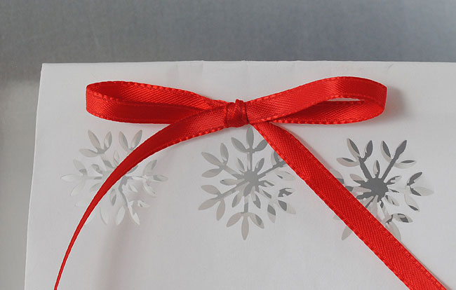 Close up of snowflake cut outs for holiday food gifts.