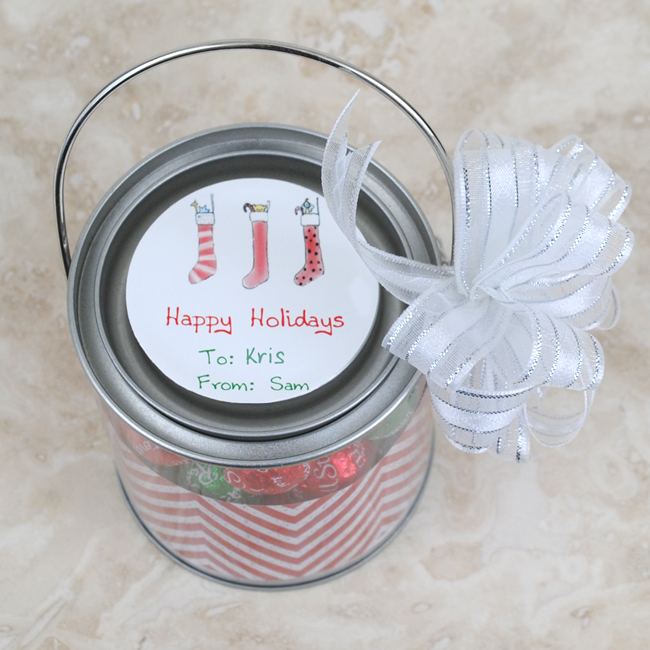 Close up of the circle sticker and mini paint can Christmas favor