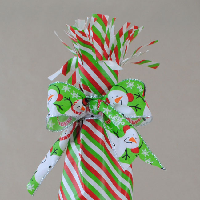 Cut slits in the top of the gift wrap and separate the two layers to make the top full looking.
