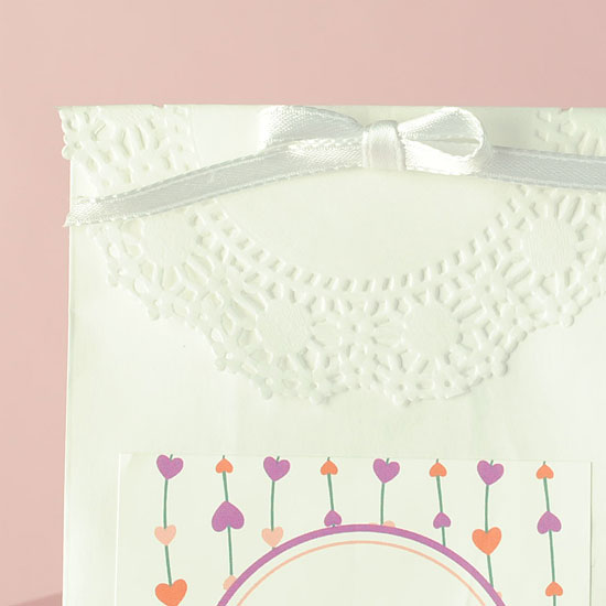 Cute! A simple bow and paper doily make this Valentine's Day favor bag amazing!