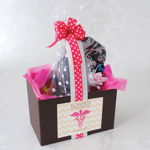 Assembled bachelorette party survival kit complete with ribbon and personalized label.