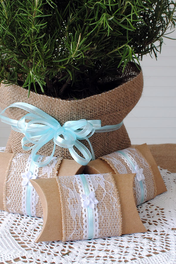 Pillow box wedding favors with burlap and lace.