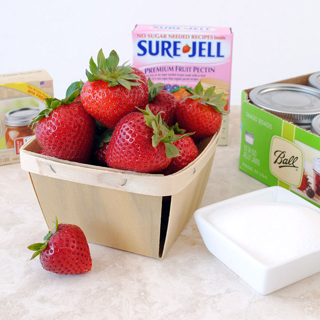 The ingredients to make strawberry jam.