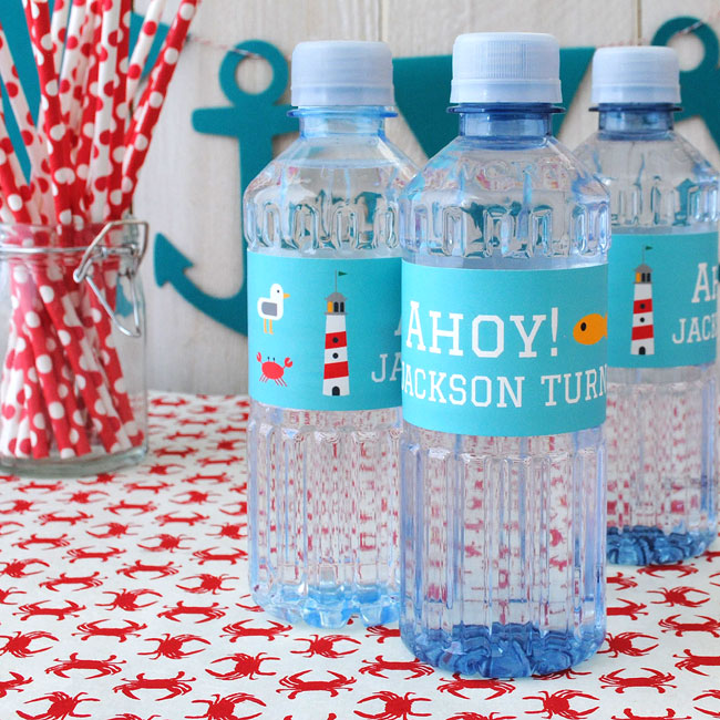 Water bottle labels with a nautical theme.
