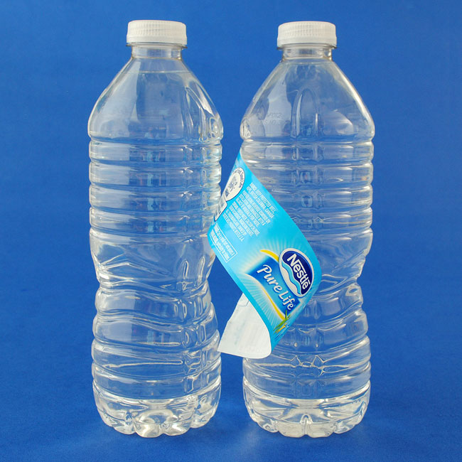 Water bottles with labels peeled off