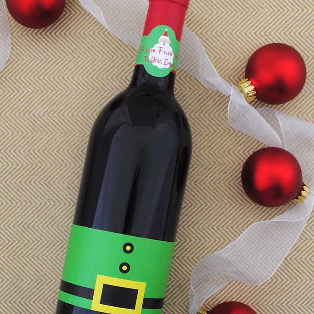 Some people know how to have fun even before the wine is opened. #santadrinkswine #holidaywinelabels #ilovewine #merlot #winemaker #customlabels #cabernet #wineparty #drinkmorewine #wineislife #instawine #Christmas2014 #bottleyourbrand #letsgetthispartystarted