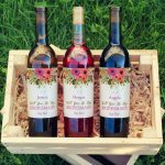 Bottles of wine with bridesmaid labels on them.