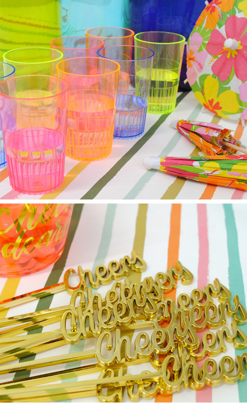 Stock the bar couples shower party details. Colorful shot glasses and cheers drink stirrers.