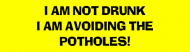 Bumper Sticker - I Am Not Drunk I Am Avoiding The Potholes